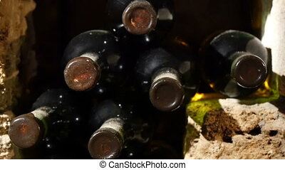 Wine Bottles In An Old Wine Cellar - Dolly shot of wine...