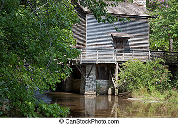 Grist mill by a lake - Wooden grist mill by a lake
