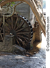 Grist mill water wheel - Wooden Grist mill with a old water...