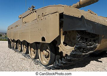 Tracks and wheels closeup of new Israeli tank in museum
