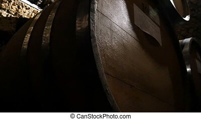 Wine Bottles And Barrels In Winery Cellar - Dolly shot of...