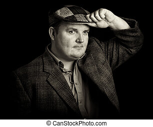 male in tweed cap on a black background - photo of male in...