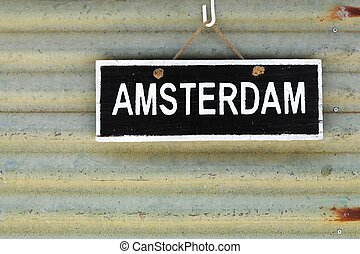 Amsterdam sign on a wall