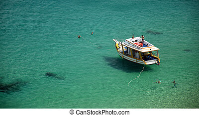 Boat in a Crystalline sea beach in Fernando de...
