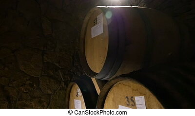 Wine Barrels Stacked In The Old Cellar - Pan down of the...
