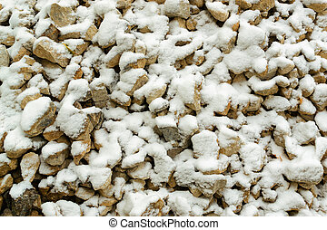 Snow on Stones - Fresh light snow falls onto many stones,...