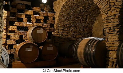Dark Wine Cellar With Big Wooden Barrels - Dolly shot of the...