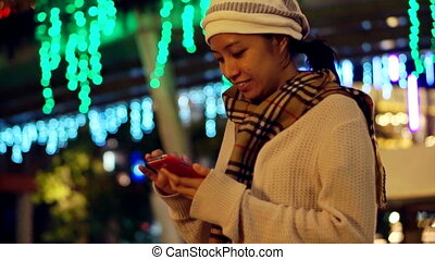 Asian girl smart phone holiday - Video of Asian girl using...