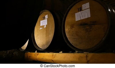 Wine Barrels In A Wine Cellar - Dolly shot of the wine...