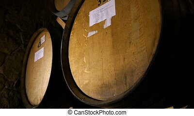 Wine Cellar with Rusty Wooden Barrels - Dolly shot of the...