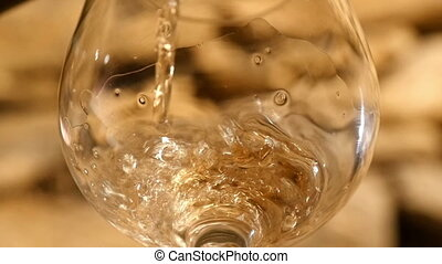 White Wine Being Poured Into Wine Glass - Close up of the...