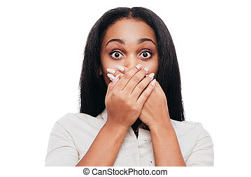 Unbelievable news Shocked young African woman covering mouth...
