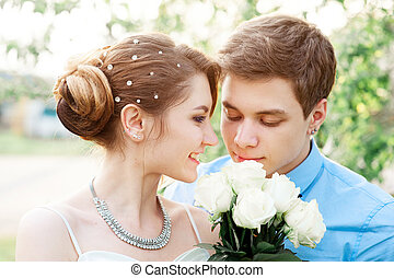bride and groom with white bridal bouquet of roses