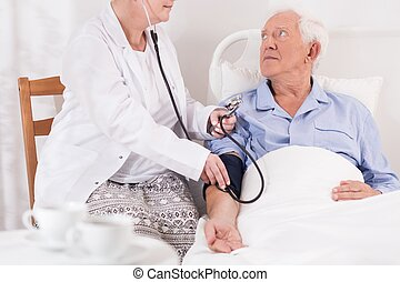 High blood pressure - Old and ill man has very high blood...