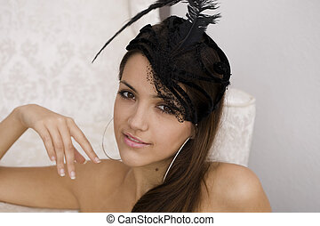 Smiling young woman in feather headdress.