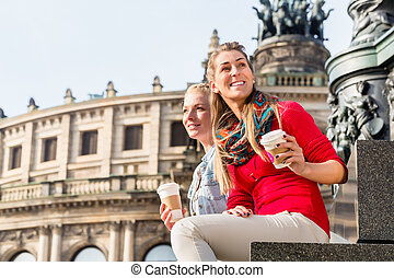 Women at Semper opera in Dresden - Women sitting in front of...