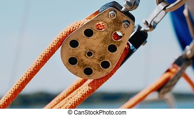 Detail yacht - a metal block with a rope