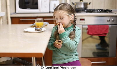 Little girl eating - little girl eating in the kitchen