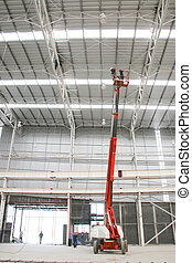 orange boom lift elevationl indoor factory - The atmosphere...