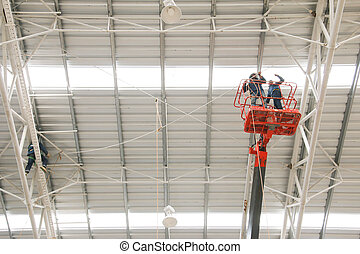 orange boom lift elevationl roof factory - The atmosphere...