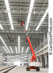 orange boom lift indoor factory - The atmosphere indoor of...