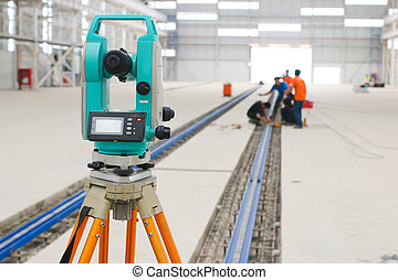 survey camera foreground with workers - The atmosphere...