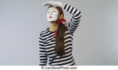 Woman mime looking through binoculars Concept: The search...