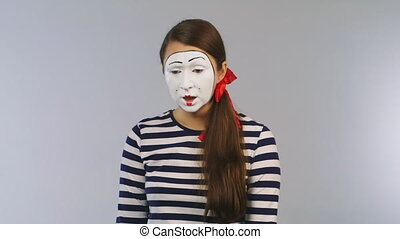Woman mime with scissors cuts the credit card