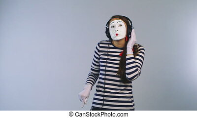 Woman mime listening to music on headphones