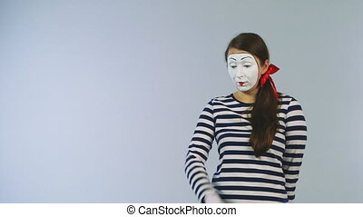 Woman mime invisible wall colors