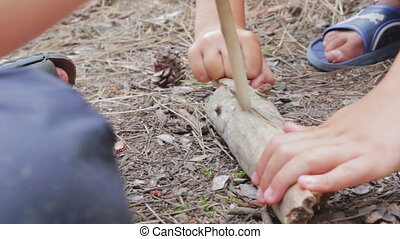 Making Fire with Wood Stick - Man in the forest turns the...