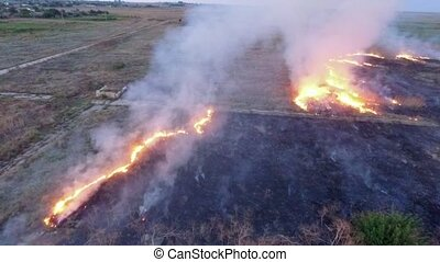 AERIAL VIEW. Dry Grass Of Field Burning In Steppe - SLOW MO:...