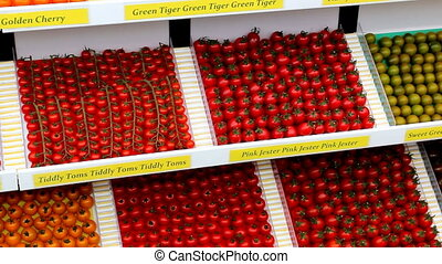 Tomatoes on display - Nicely arranged variety of tomatoes on...