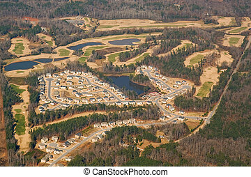 Aerial view of a golf course and housing development