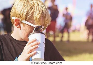 Boy drinking from a plastic cup