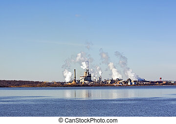 Factory on a river in Virginia - Factory smokestacks on the...
