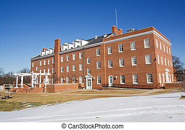 Foster Hall on the campus of Virginia State University near Petersburg, Virginia, one of the public, Historically Black Colleges and Universities (HBCUs) with blue sky and white snow in winter
