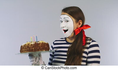 Cheerful girl with a birthday cake Concept: celebration,...
