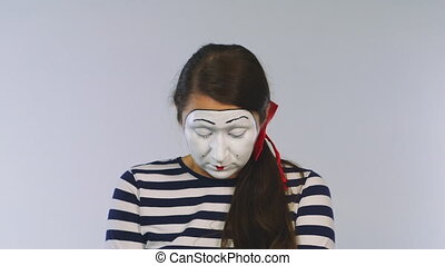 The mime girl is crying