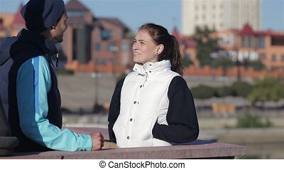 Two runners man and woman talking before jogging