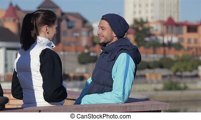 Man and woman talking before jogging