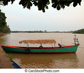 Boat on Kampot river. Kampot. Cambodia. - Traditional boat...