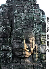 Close-up of face of the king in the temple of Bayon, Angkor...