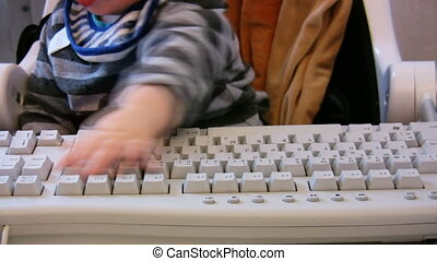 Baby typing on computer keyboard 1