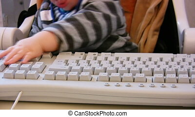 Baby typing on computer keyboard 3