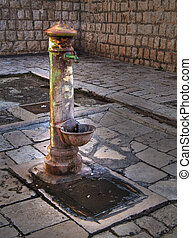 Old fountain. - This is an old rusty fountain in an ancient...