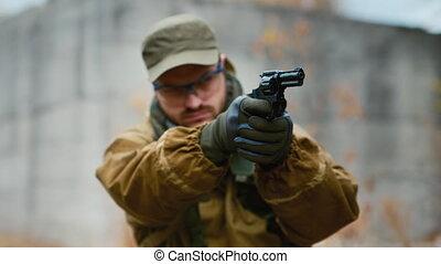 Portrait of a man firing a revolver