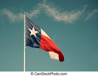 State flag of Texas against blue sky