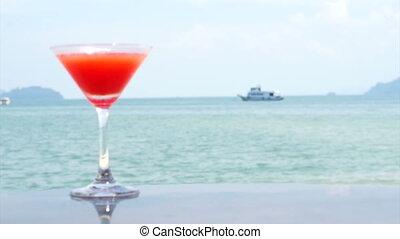 red cocktail summer tropical beach