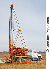 well drilling rig - rustic well drilling rig in the farm